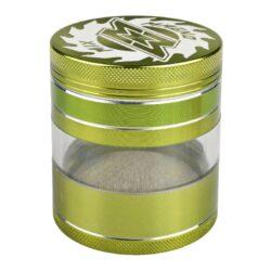 Drtič tabáku Magno Alu, 63mm, 6mix.-Kovový drtič tabáku s kličkou značky Magno. Kvalitní čtyřdílná drtička se závitem, sítkem a průhledným zásobníkem na tabák je vyrobena z kvalitního hliníku CNC technologií. Povrch je upraven eloxováním v metalickém barevném provedení, na horní a čelní straně drtiče je umístěné logo. Jednotlivé díly drtičky jsou pevně spojené na závit. Klička je sklopná, takže nepřekáží při přenášení drtiče. Precizně broušené ostří nožů, které jsou ve tvaru diamantu, velmi jemně nadrtí vaší směs. Rozměry: průměr 62mm, výška 78mm. Cena je uvedena za 1 ks. Před odesláním objednávky uveďte číslo barevného provedení do poznámky.